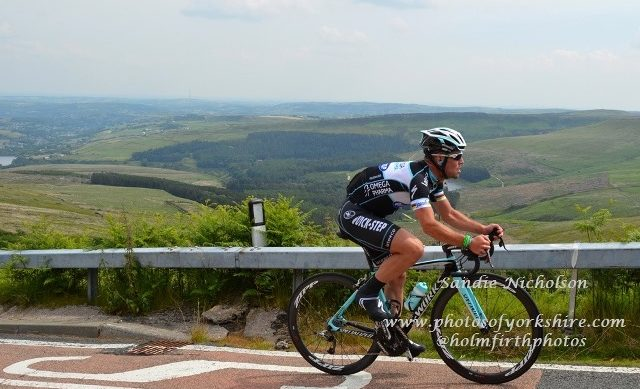 Mark Cavendish cycling high above Yorkshire
