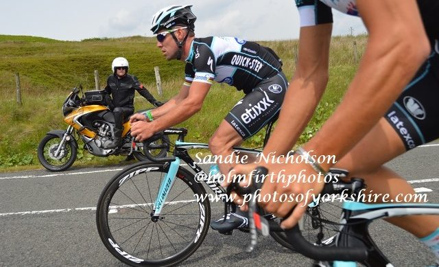 Mark Cavendish as outrider looks on